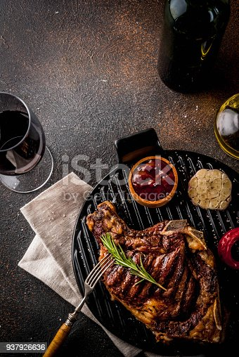 808351132 istock photo Fresh grilled meat beef steak with with red wine, herbs and spices. 937926636