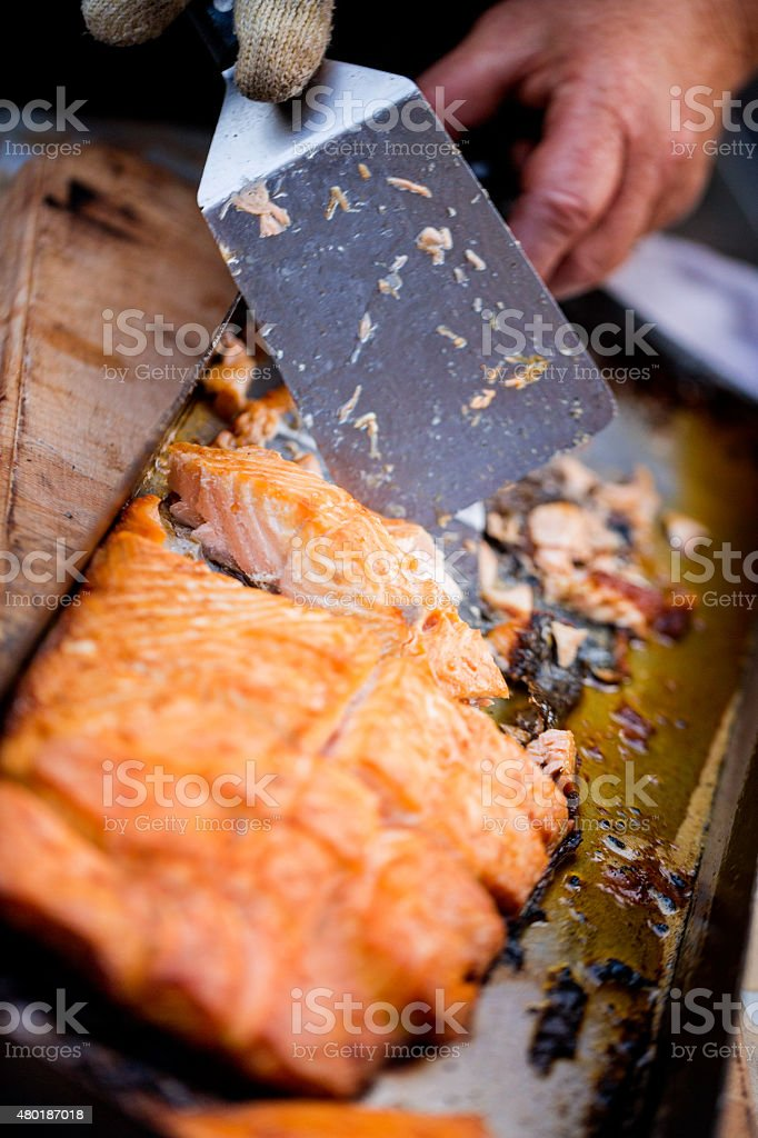 Fresh grilled salmon being dished up with a spatula stock photo