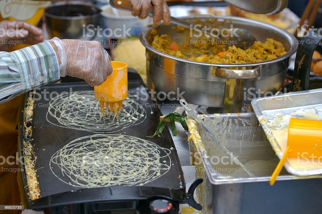Fresh Grilled Treats at a Food Stall stock photo