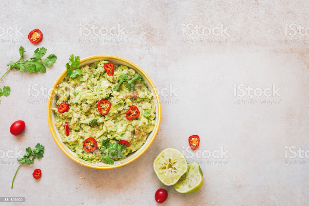 Fresh guacamole dip with ingredients stock photo