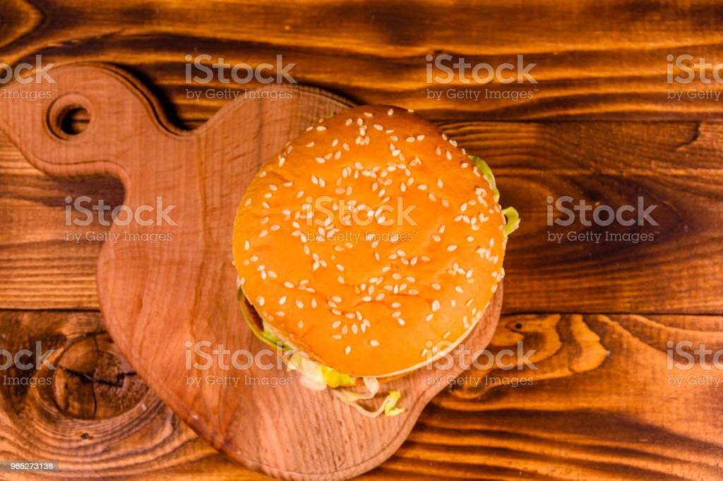 Fresh hamburger on the rustic wooden table. Top view zbiór zdjęć royalty-free