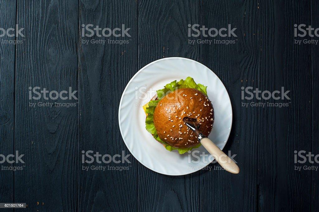 Fresh hamburger with fork on white plate photo libre de droits