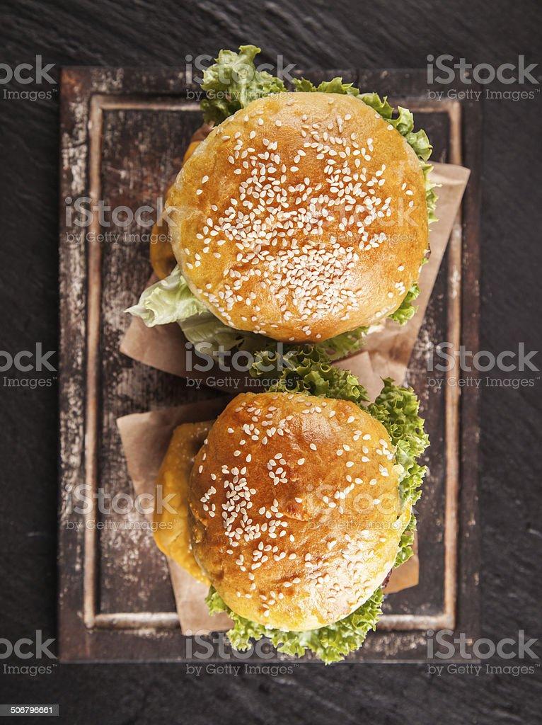 Fresh hamburgers on black stone, top view stock photo