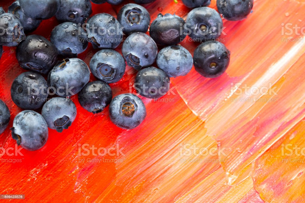 Fresh healthy berries of blueberries on red canvas stock photo