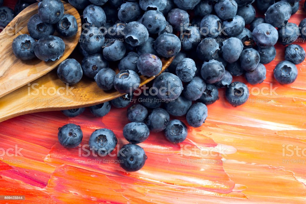 Fresh healthy berries of blueberries with wooden spoons stock photo