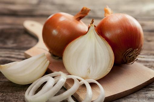 Fresh healthy onions on chopping board