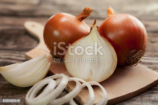 istock Fresh healthy onions on chopping board 836586846