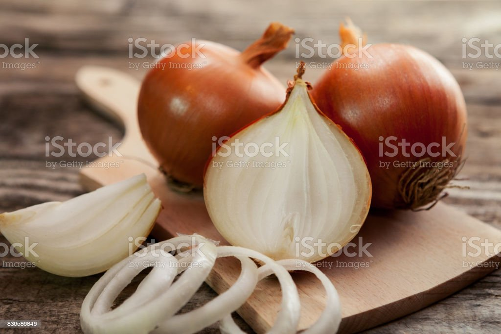Fresh healthy onions on chopping board stock photo