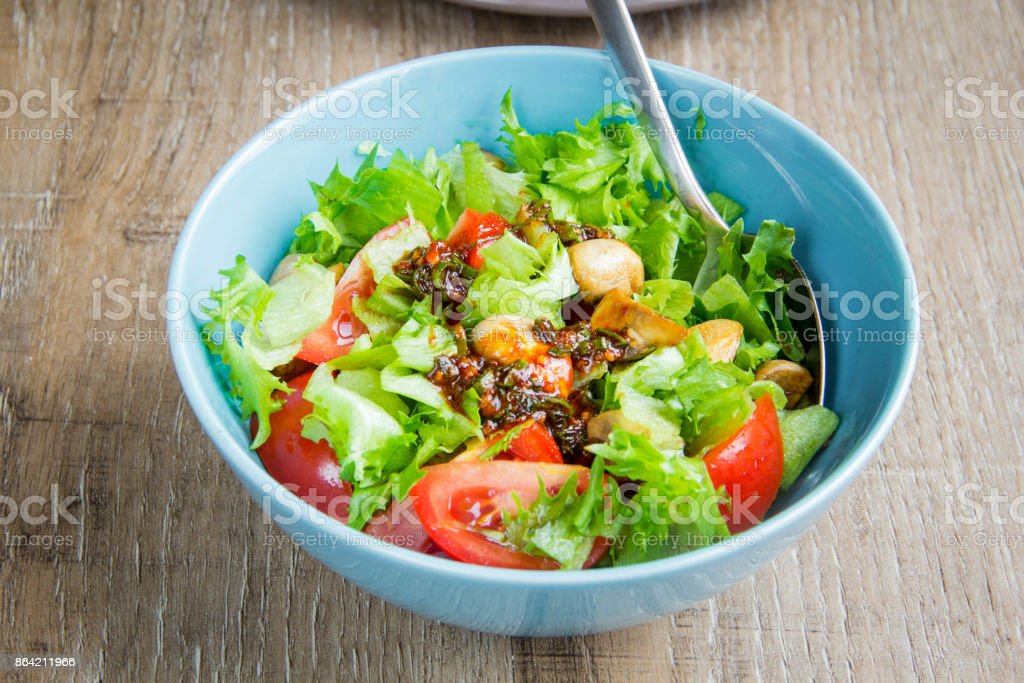 Fresh healthy salad with lettuce, tomatoes, tasty summer dish, diet food royalty-free stock photo