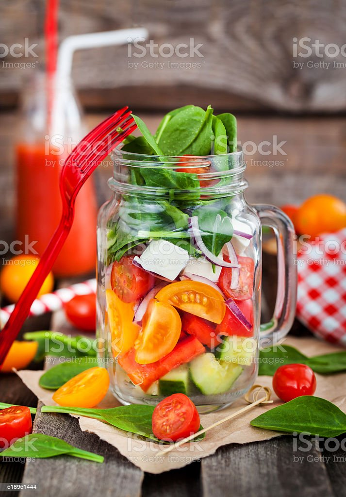 Fresh healthy vegetable salad in glass jar stock photo