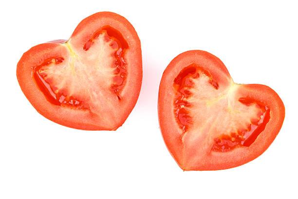 Fresh heart-shaped tomato stock photo