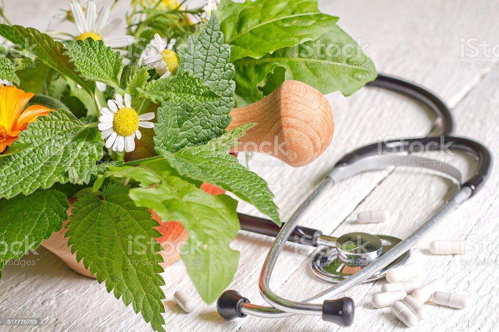 Fresh herb and stethoscope alternative medicine stock photo