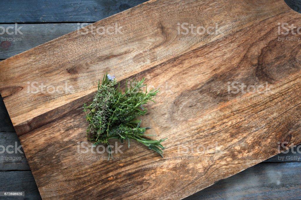 Fresh herbs on a cutting board stock photo