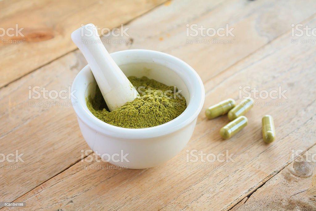 Fresh herbs powder in the mortar, alternative medicine stock photo