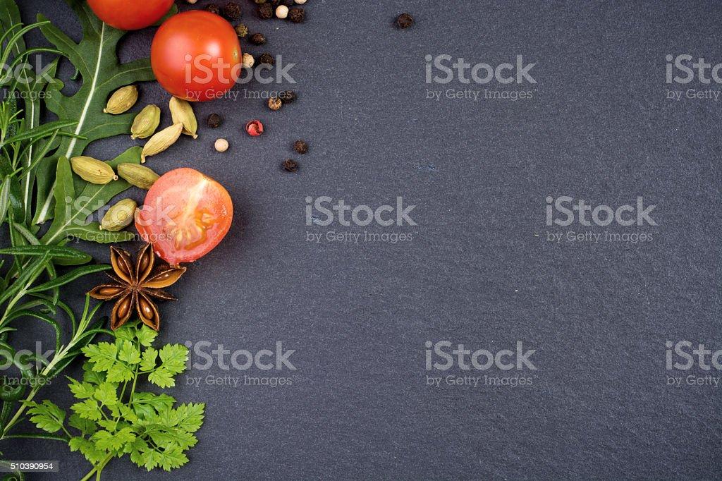 Fresh herbs, tomatoes and seasonings stock photo