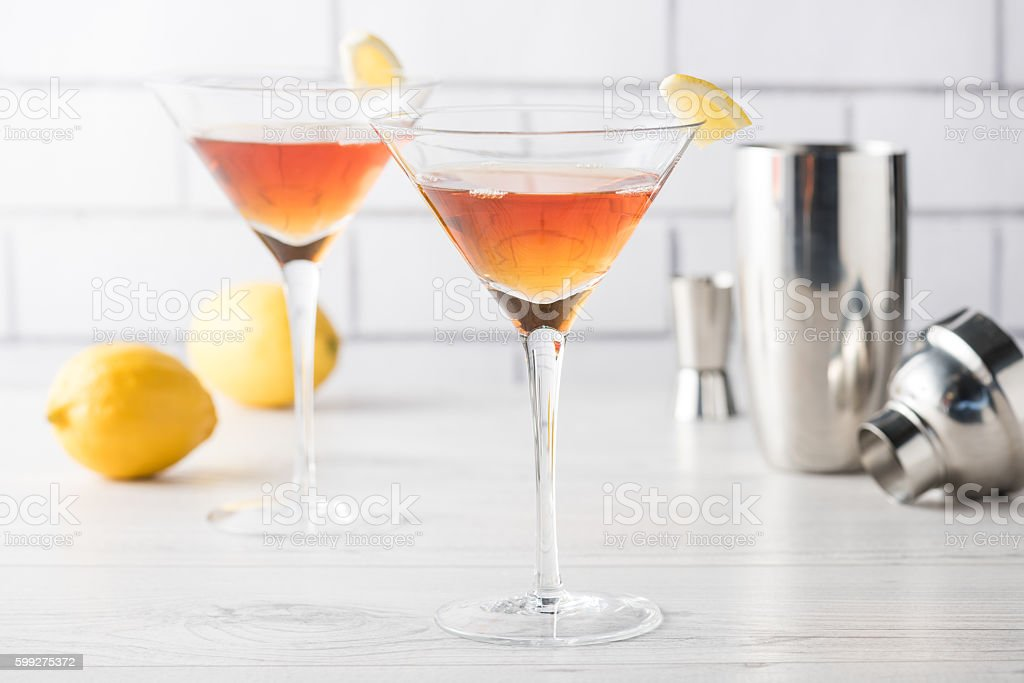 Fresh home made Manhattan cocktails with garnish stock photo