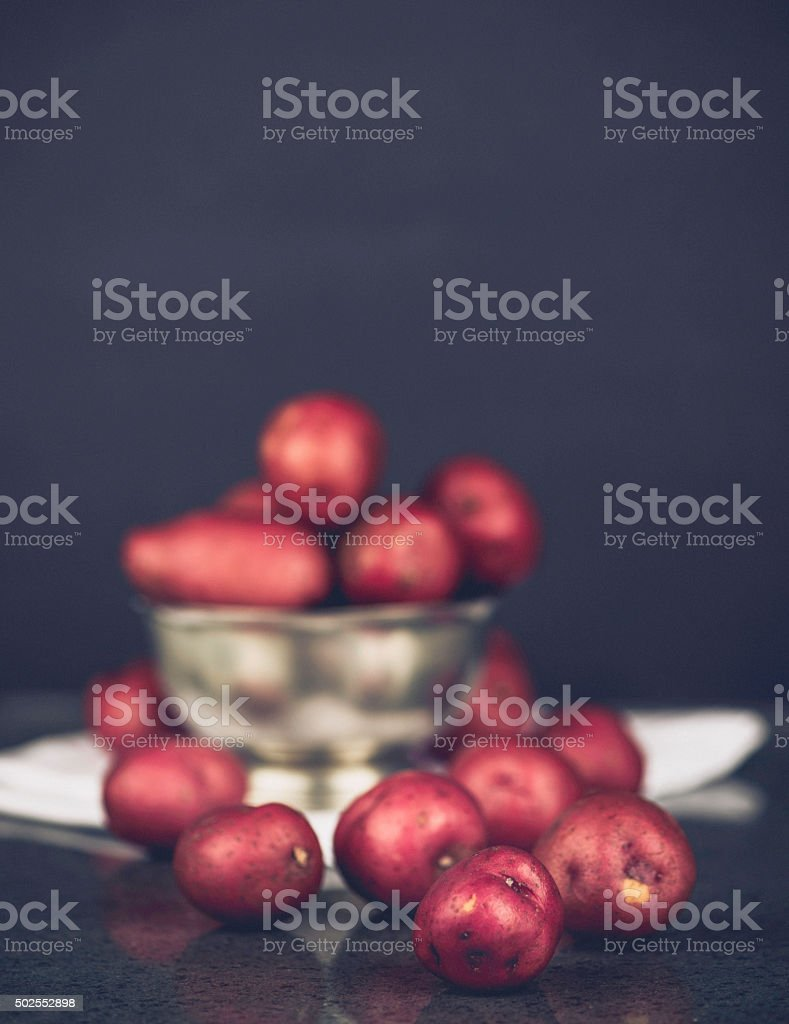 Fresh homegrown baby red potatoes in silver bowl stock photo