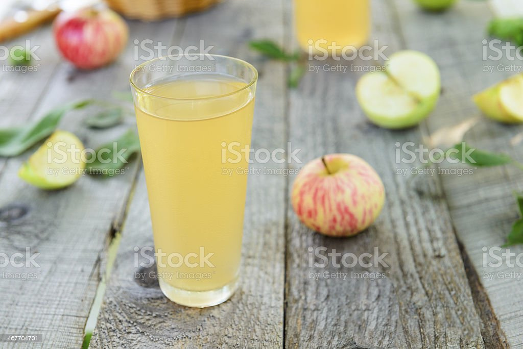 Fresh homemade apple juice and apples stock photo