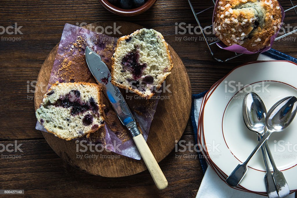 Fresh homemade blueberry muffin, cut in half stock photo