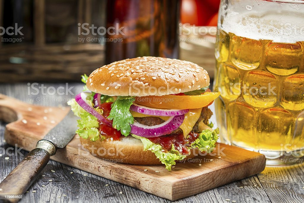 Fresh homemade burger and a cold beer royalty-free stock photo