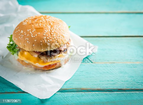 Fresh homemade burger cheeseburger on blue wooden