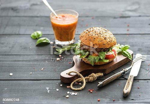 istock Fresh homemade burger on dark serving board with spicy tomato 508882248