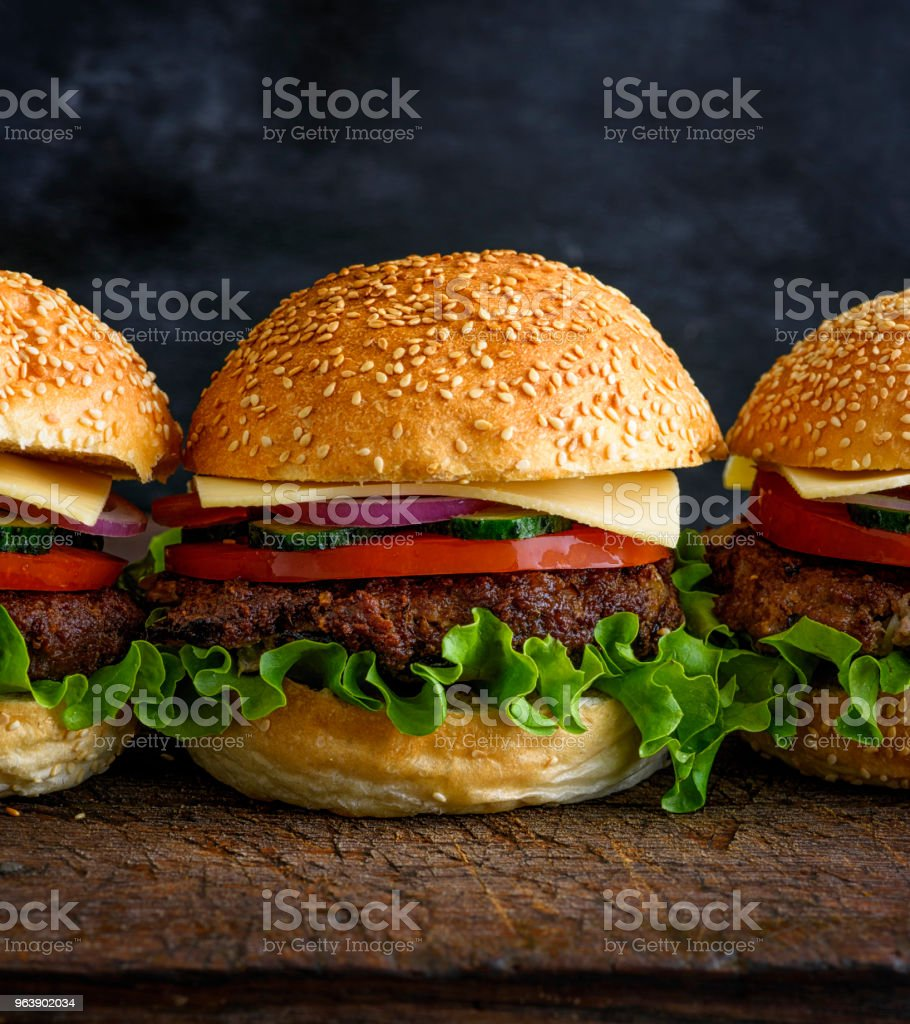 fresh homemade burger with lettuce, cheese, onion - Royalty-free American Culture Stock Photo