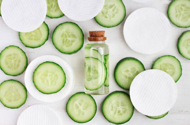 Fresh homemade cucumber facial toner in bottle, stock photo