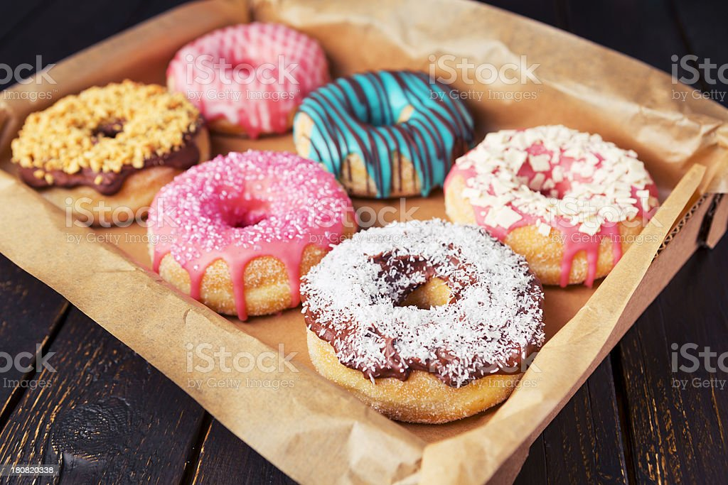 Fresh homemade donuts with various toppings stock photo