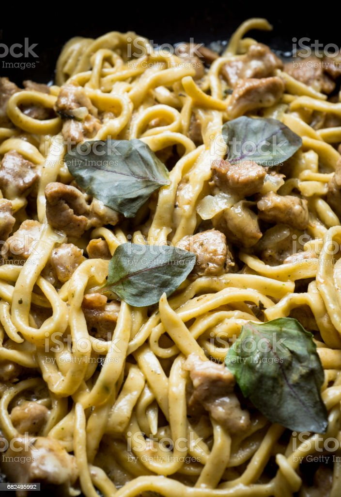 Fresh homemade fettuccini pasta with meat, cheese and basil royalty-free stock photo