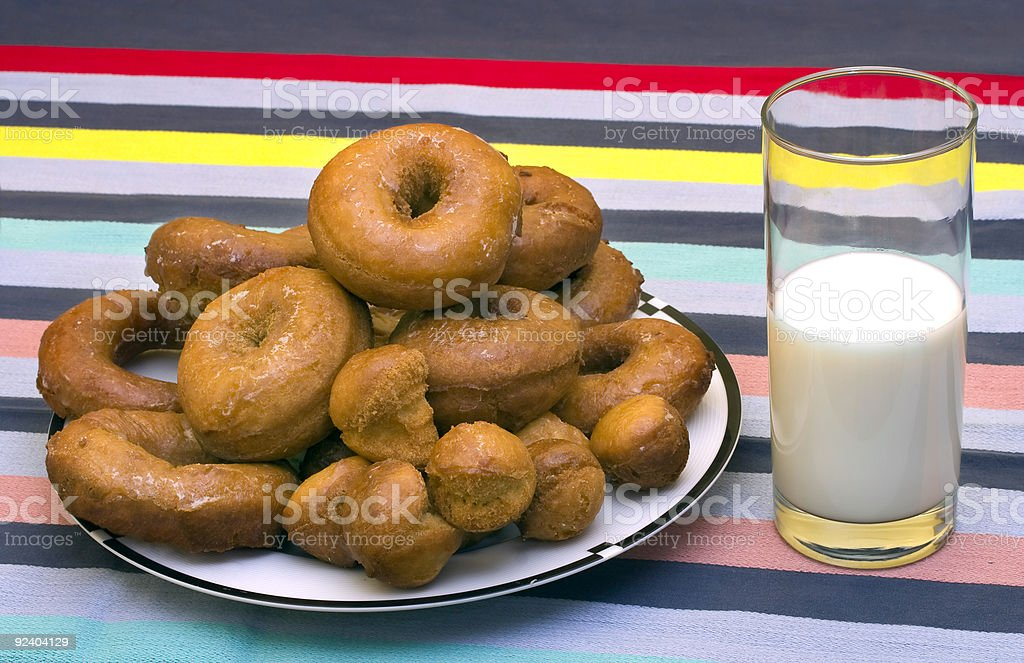 Fresh Homemade Glazed donuts with glass of Milk royalty-free stock photo