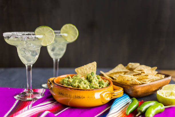fresh homemade guacamole - margarita drink stock photos and pictures