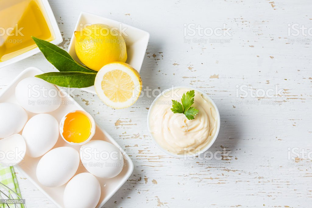 Fresh homemade Mayonnaise and ingredients on white background stock photo