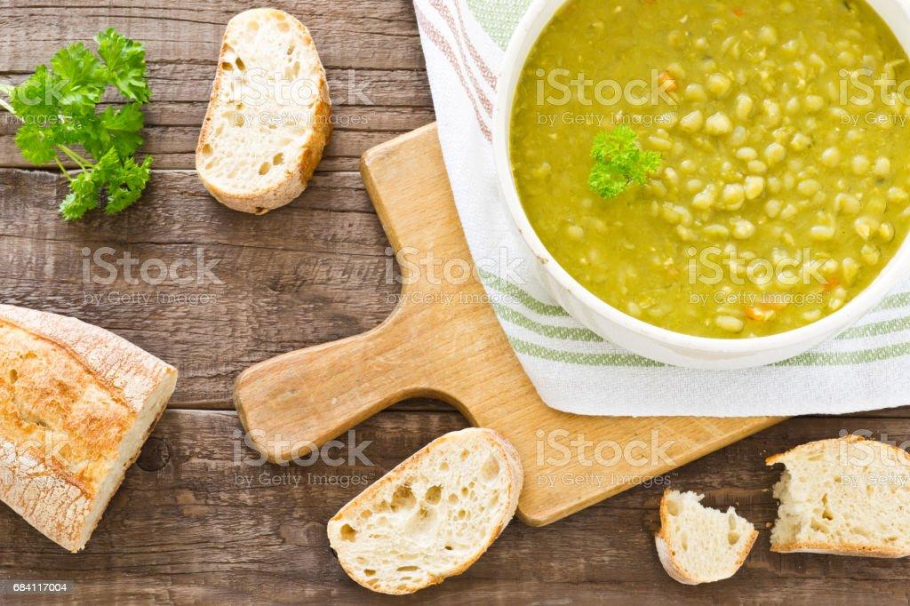 Fresh homemade pea soup with bread zbiór zdjęć royalty-free