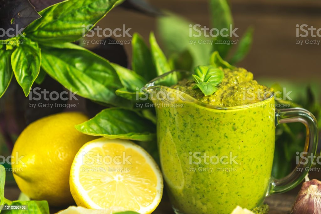Fresh homemade pesto sauce close up and food ingredients stock photo