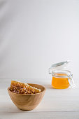 fresh honey and honeyons on a white background with copy space