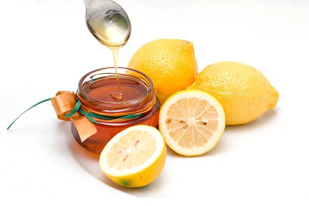 Fresh honey and lemons stock photo