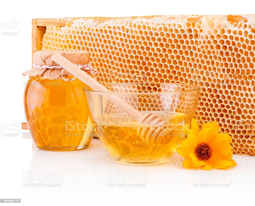 Fresh honey with honeycomb isolated on white background royalty-free stock photo