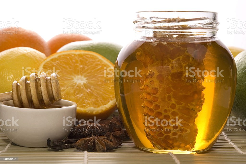 fresh honey with honeycomb, spices and fruits royalty-free stock photo
