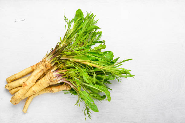 Fresh horseradish. The white Wooden desk. Top view. Fresh horseradish. The white Wooden desk. Top view. horseradish stock pictures, royalty-free photos & images