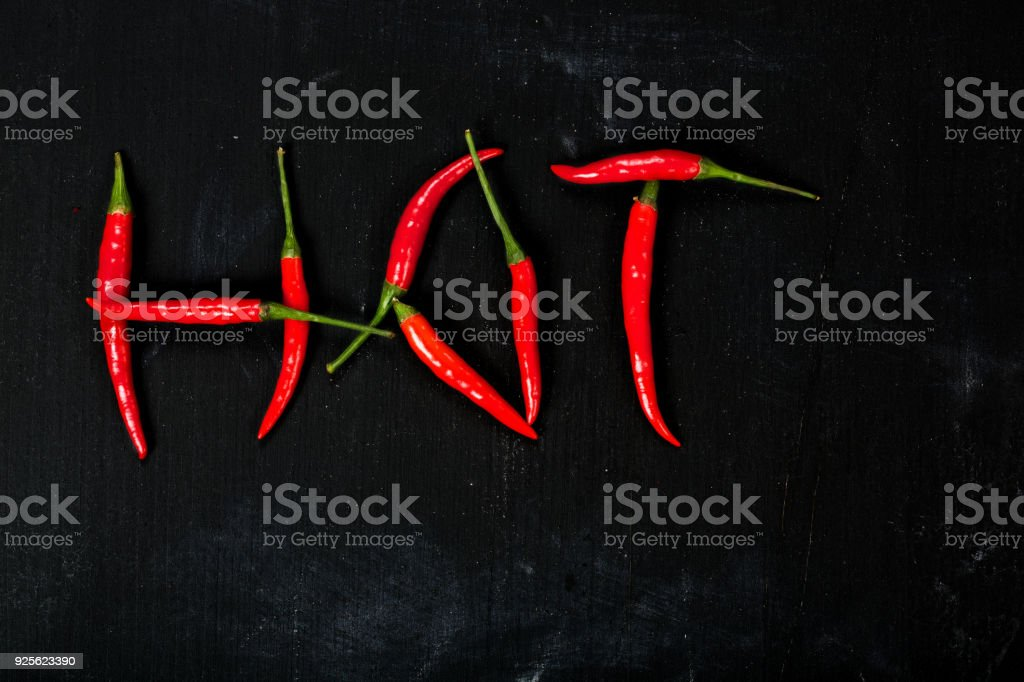 Fresh hot chili pepper on a wooden surface. stock photo