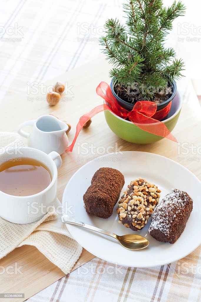 Fresh hot green tea in white cup with chocolate cakes royalty-free stock photo