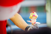 Hand Holding a Fresh Ice Cream Cone with Candies,Ice Cream Cone with hand