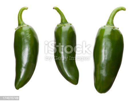 Three perfect fresh jalapeno chilis isolated on a white background
