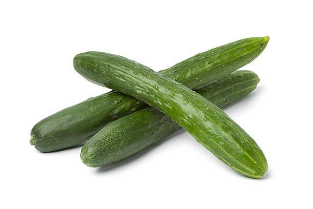 fresh japanese cucumbers - komkommer stockfoto's en -beelden