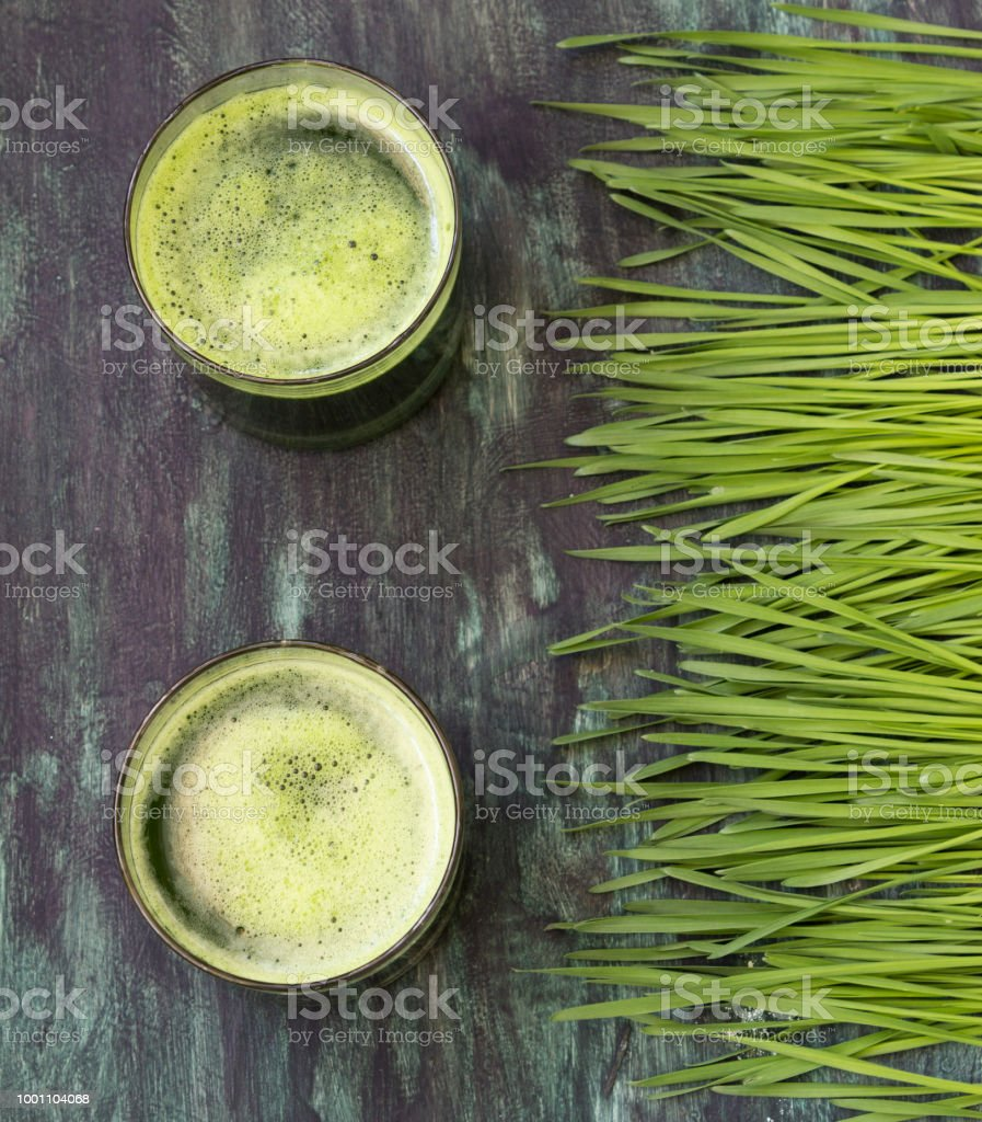 Fresh juice from wheat grass stock photo