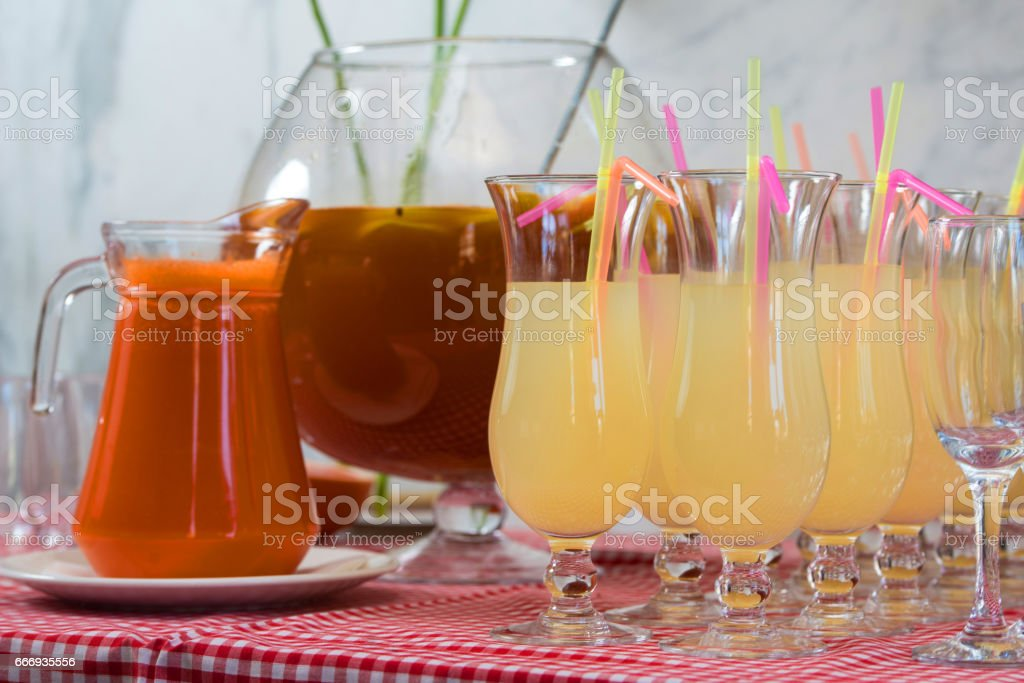 Fresh juice on a table in a restaurant. Healthy drinks. carrot fresh in a jar stock photo