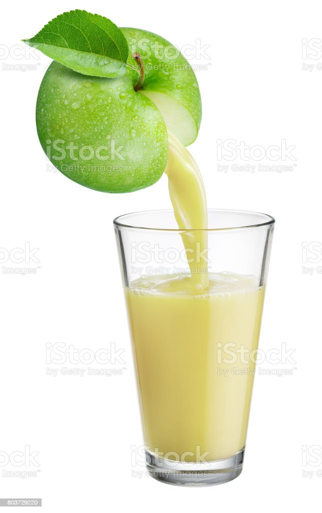 Fresh juice pours from apple fruit into the glass isolated on white background. stock photo
