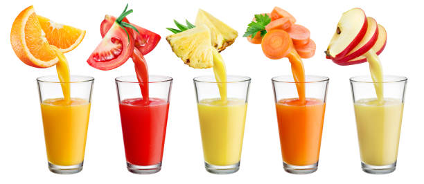 Fresh juice pours from fruit and vegetables into the glass isolated on white background. Fresh juice pours from fruit and vegetables into the glass isolated on white background. vegetable juice stock pictures, royalty-free photos & images
