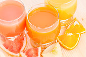 Fresh juice with different pieces of fruits. Top view vitamins healthy eating background